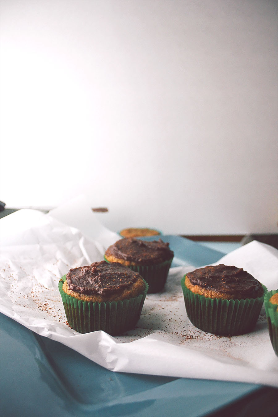 healthy banana muffins with ganache frosting