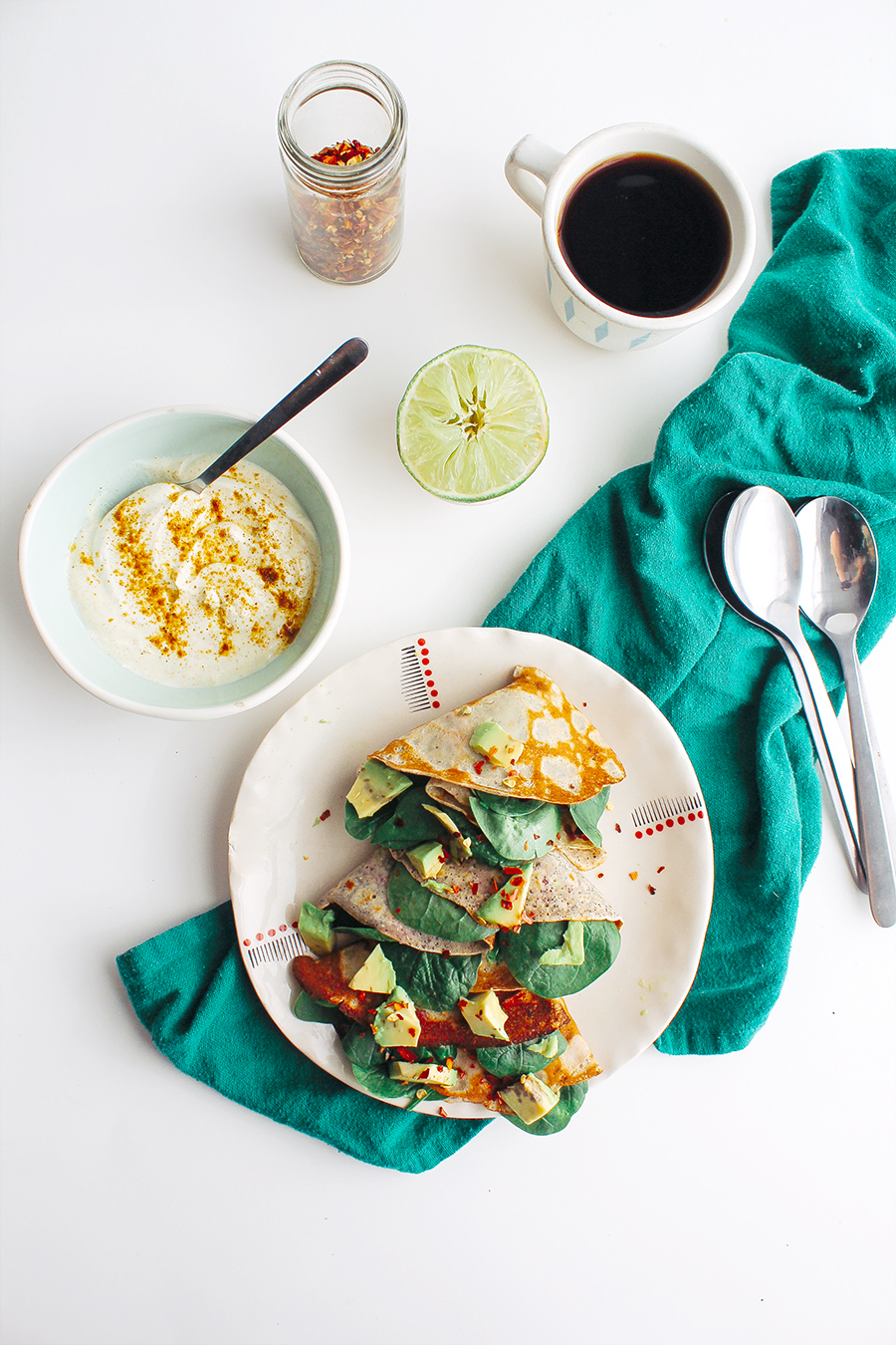 Spinach & Avocado Stuffed Cornmeal Crepes with Curry-Lime Cream