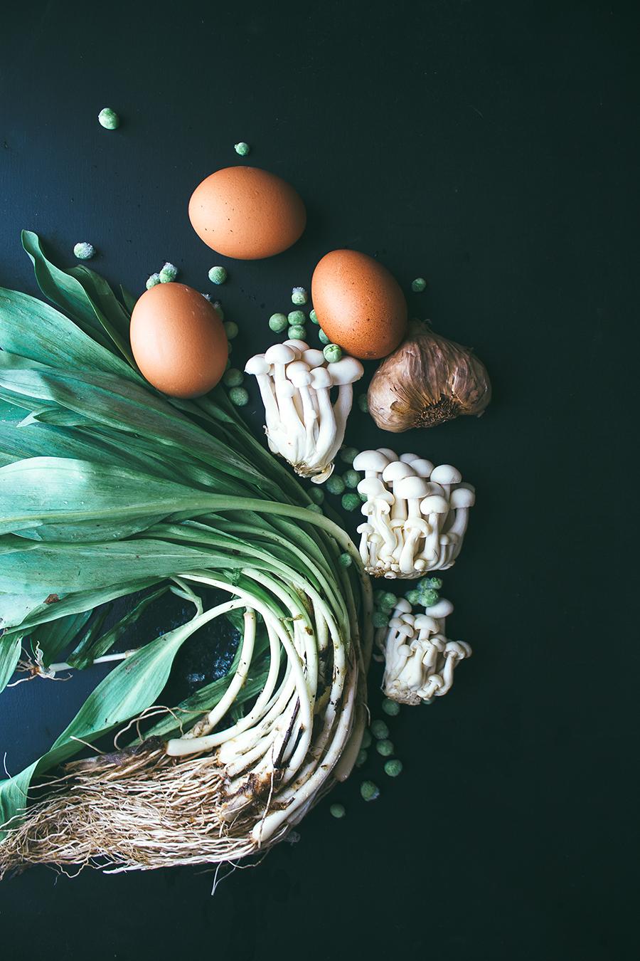 veggie quiche ingredients on dark background