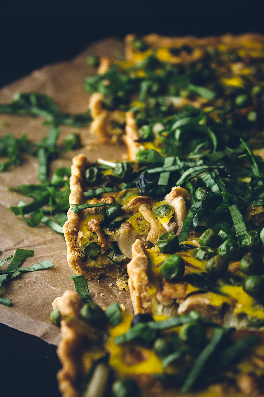 loaded veggie quiche on brown towel