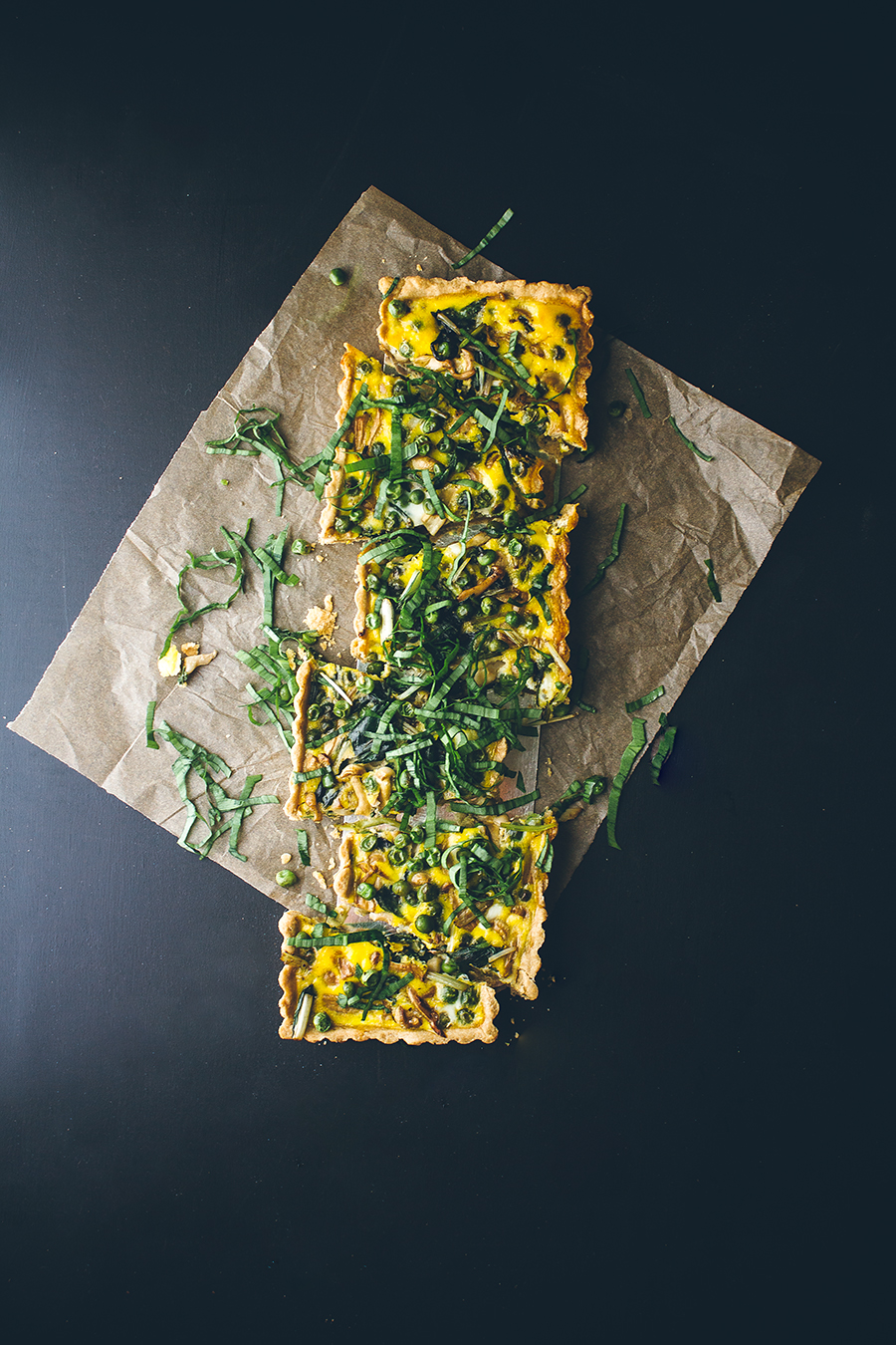 loaded vegetarian quiche on parchment paper