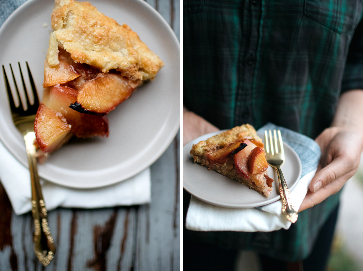 slice of Plum Galette With Hazelnut Frangipane on white plate with fork