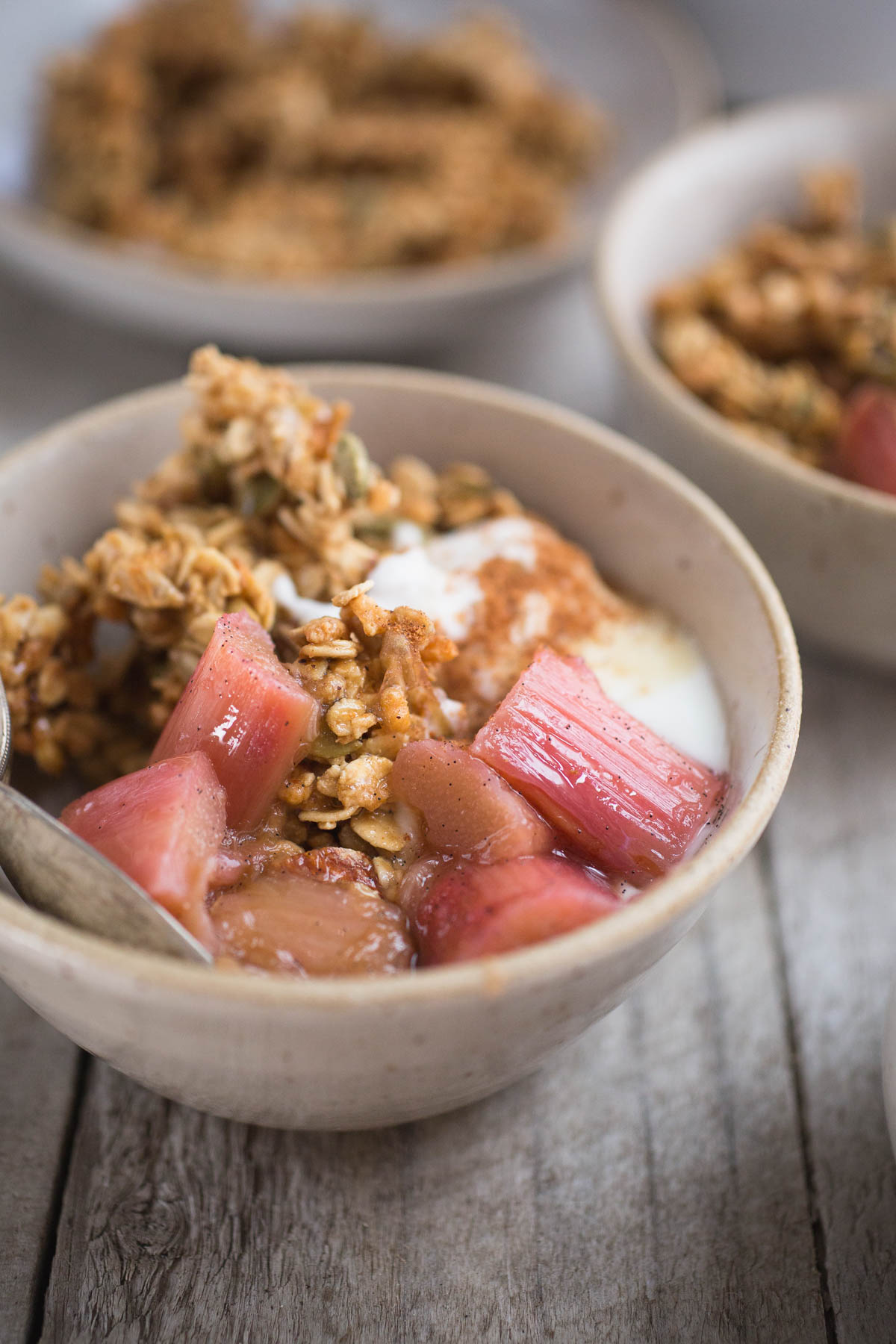 Clumpy Granola Bowl with Stewed Rhubarb and Yogurt