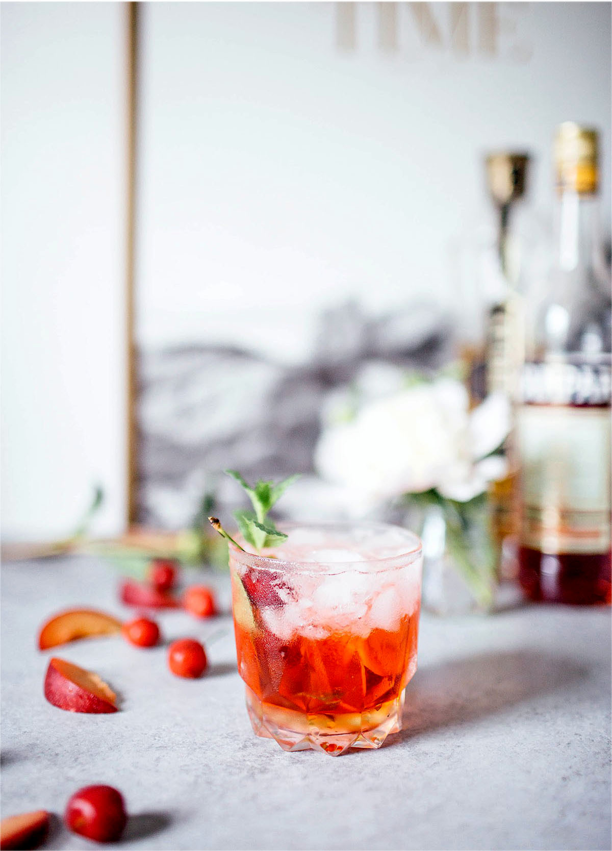 St. Germain Spritz garnished with cherries and fresh mint