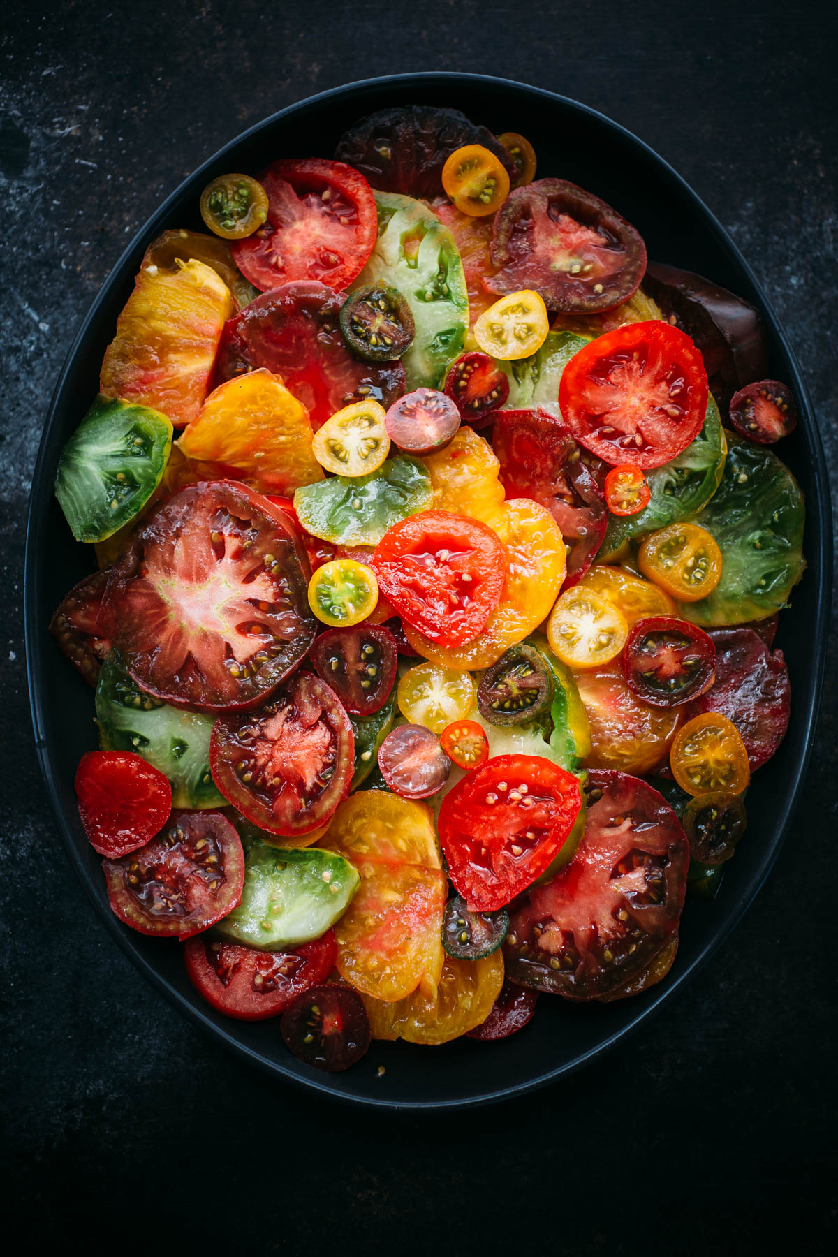 sliced heirloom tomatoes in large serving platter