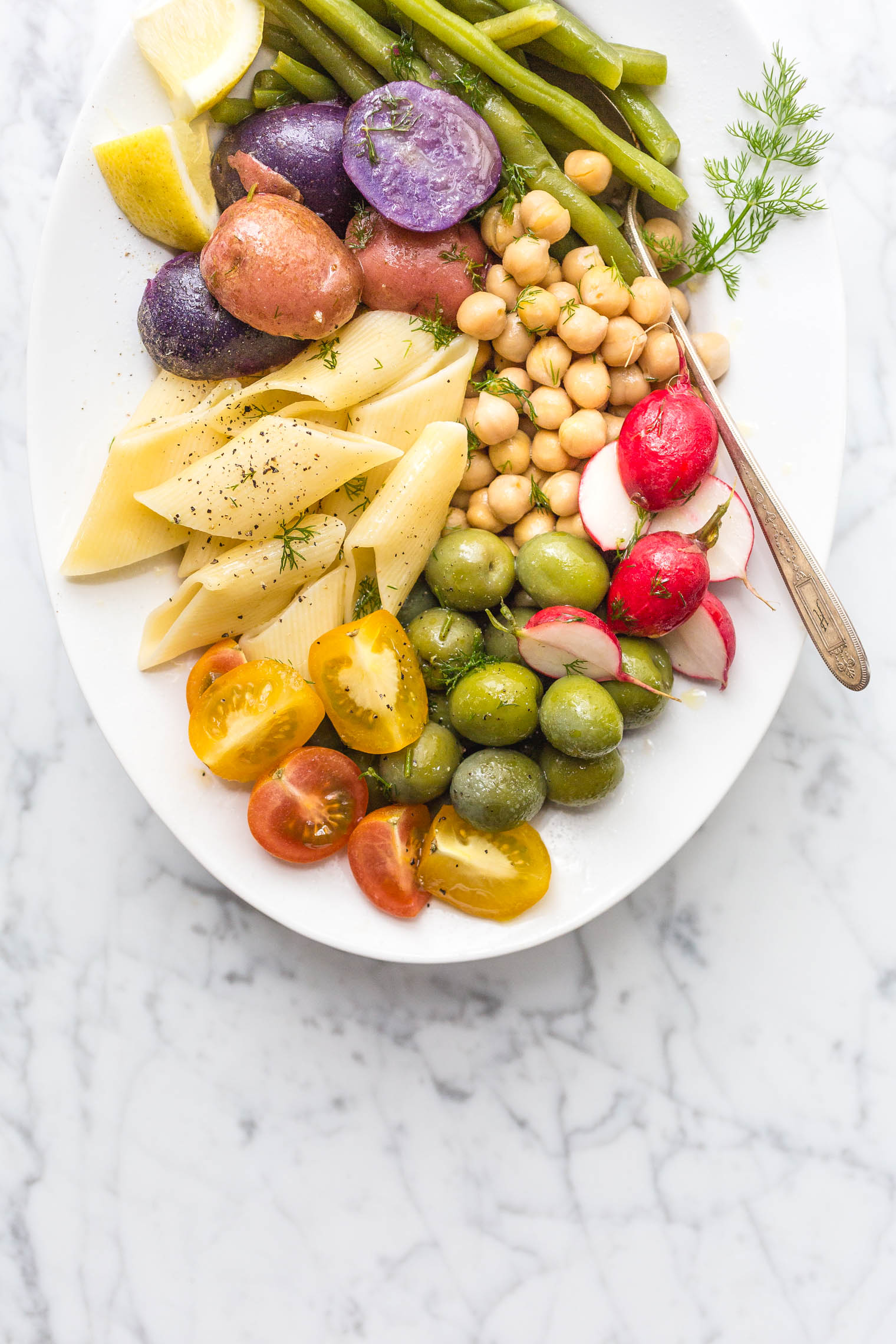 vegetarian dill pasta salad on white platter