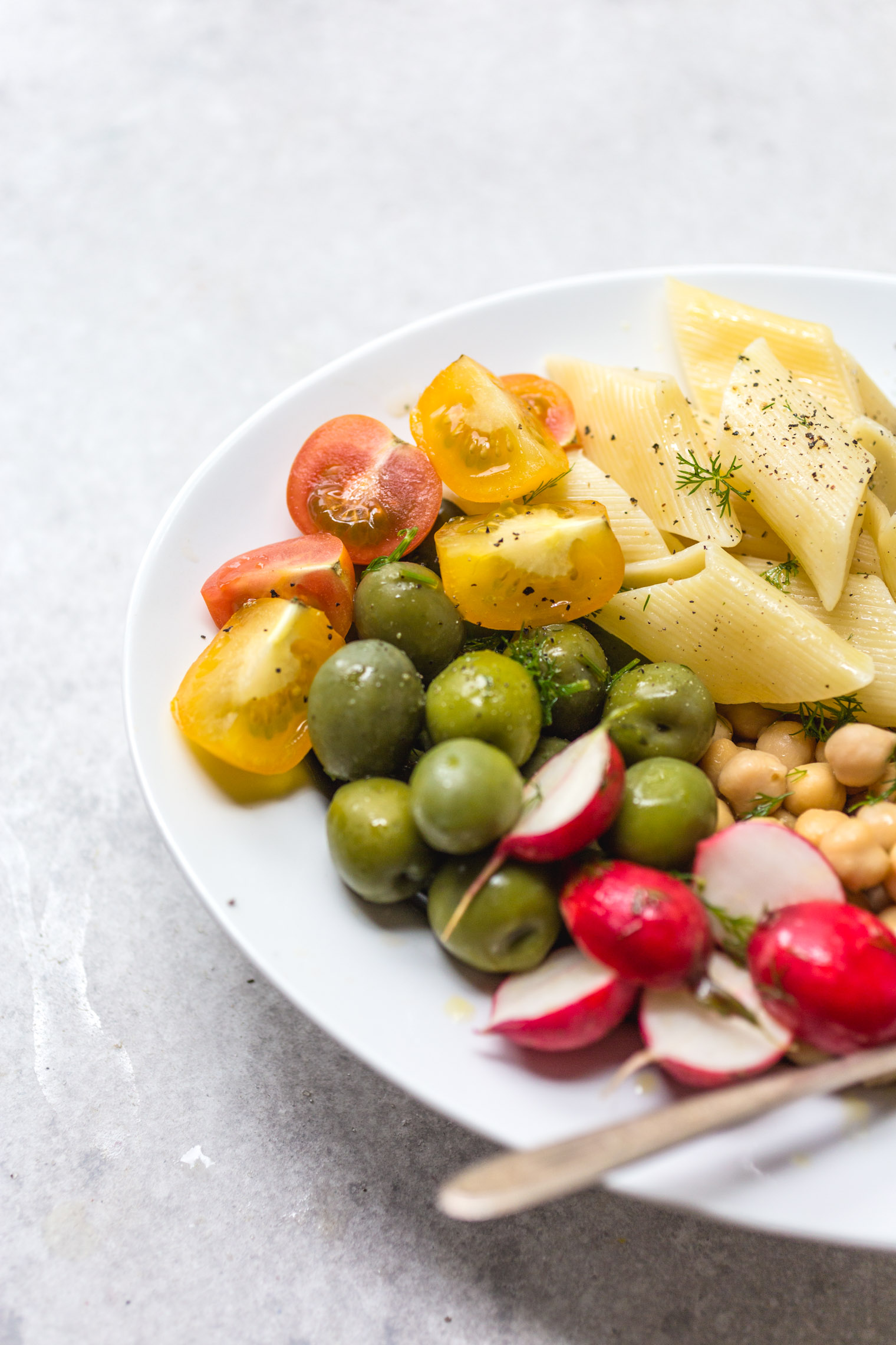 summer pasta salad on white platter