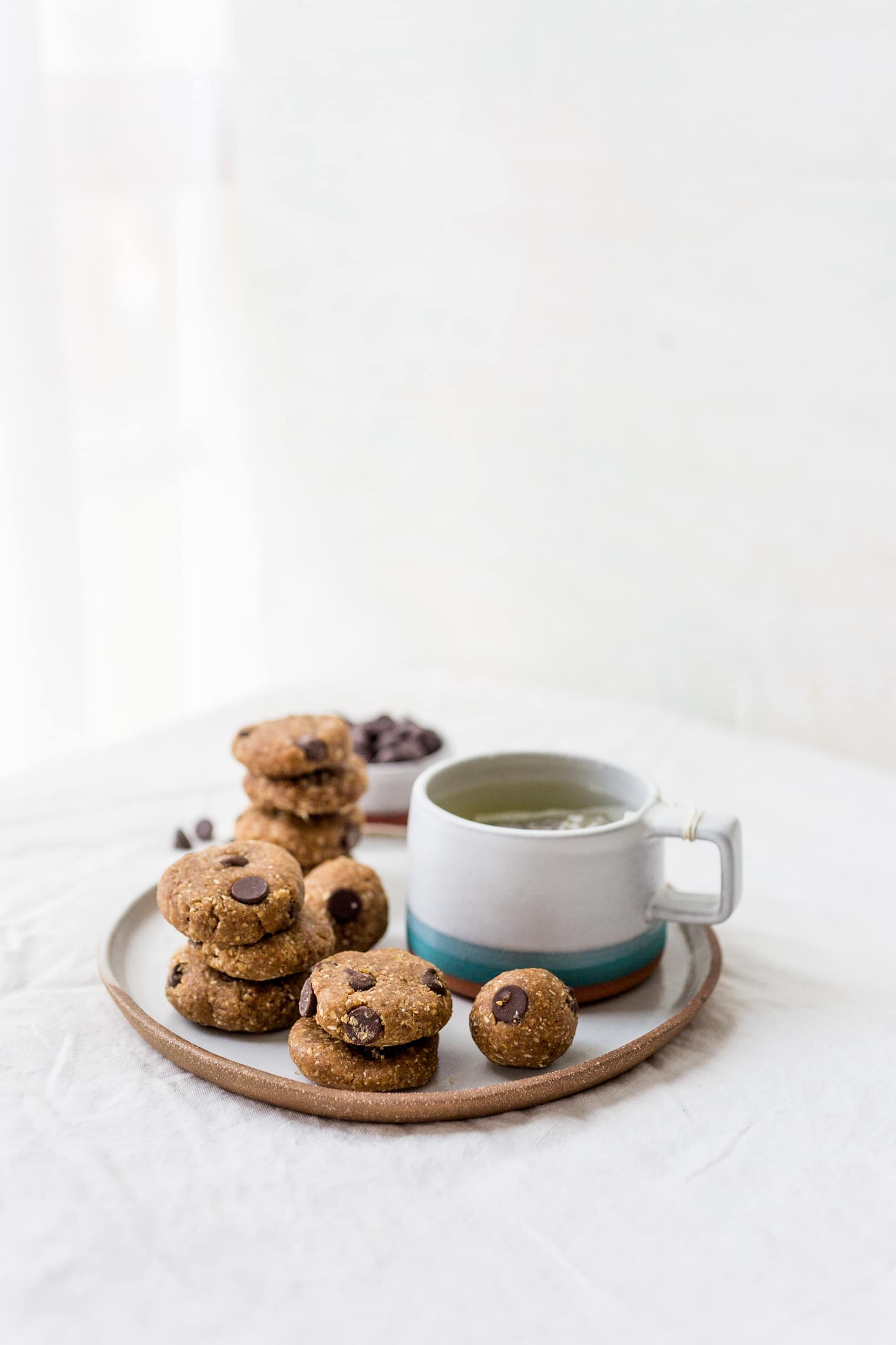 Cookie Dough Balls on plate with mug of tea