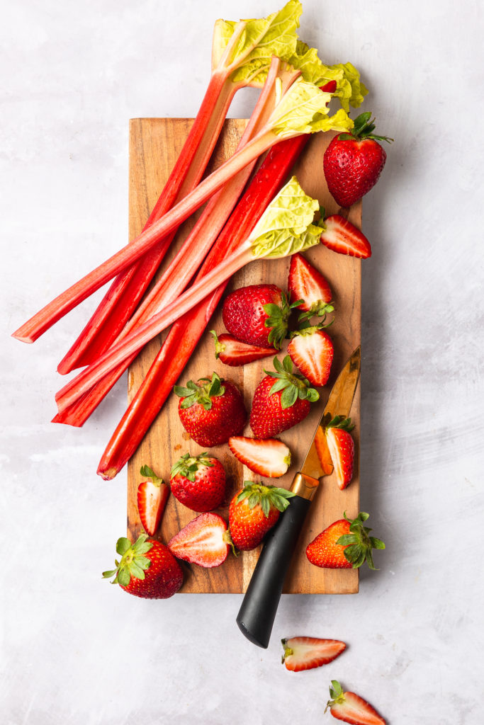 strawberry and rhubarb on cutting board