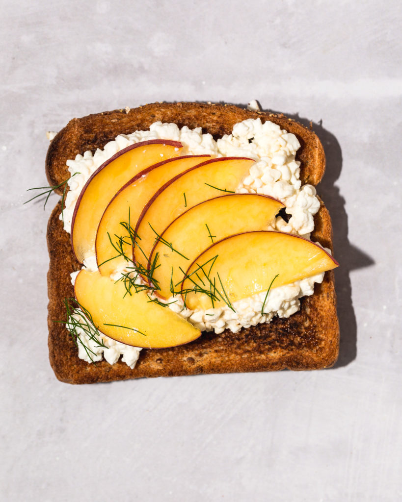 sliced peach, honey, and cottage cheese on toast
