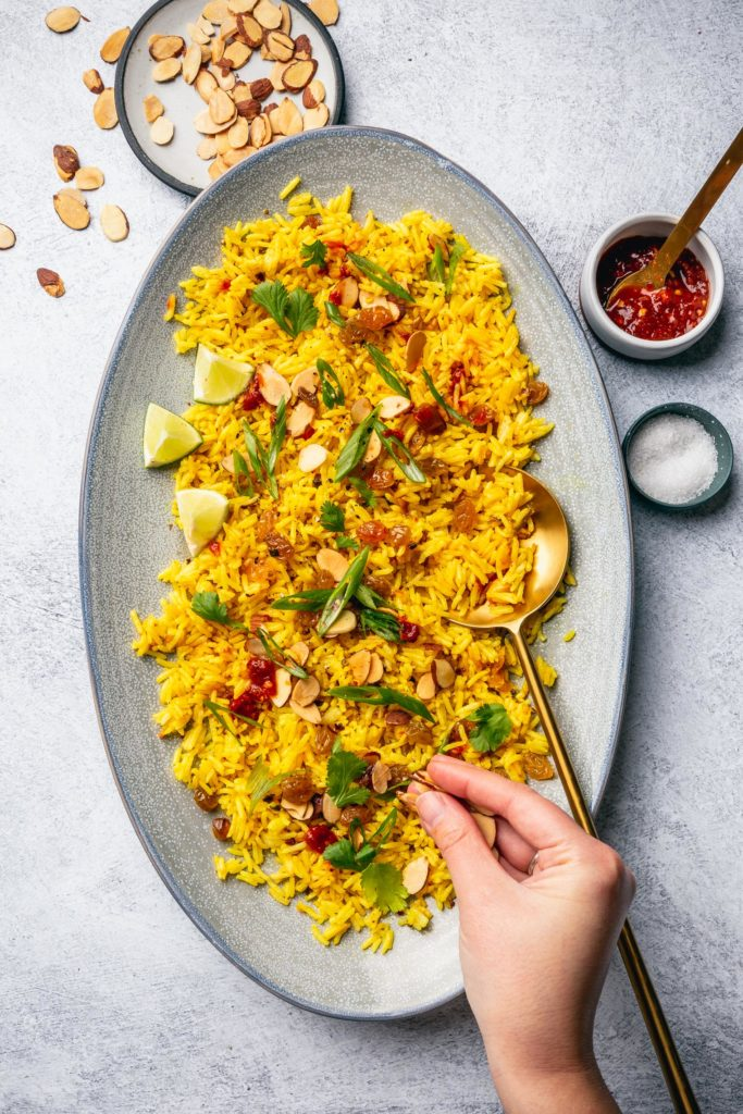 Turmeric Rice with Quick Pickled Golden Raisins & Toasted Almonds
