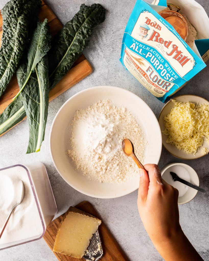 stirring dough for Cheesy Kale Scones with Manchego