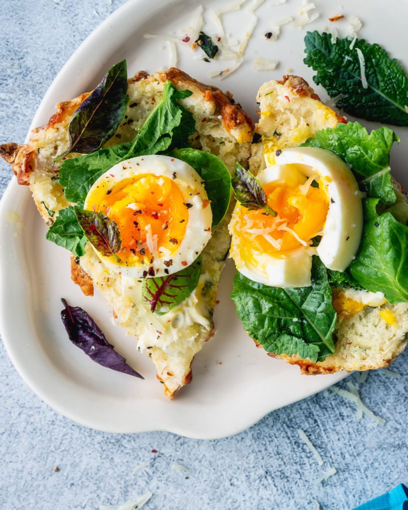 Cheesy Kale Scones with Manchego topped with egg and kale