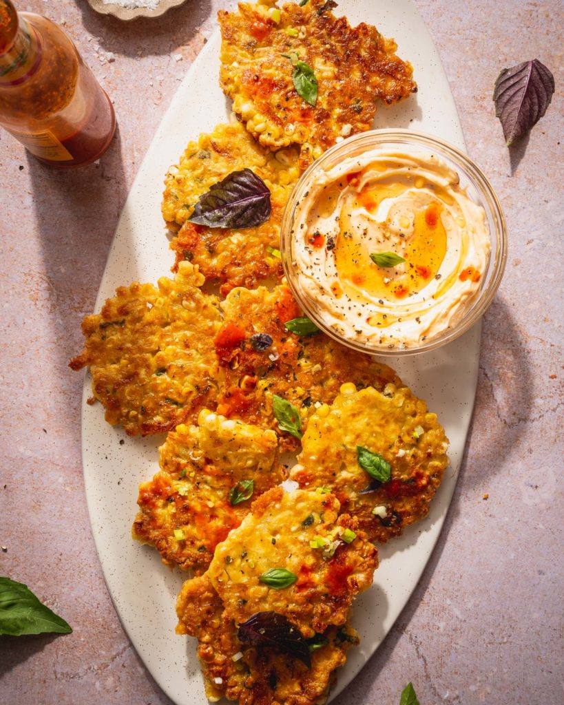 corn fritters on a serving platter ready to eat