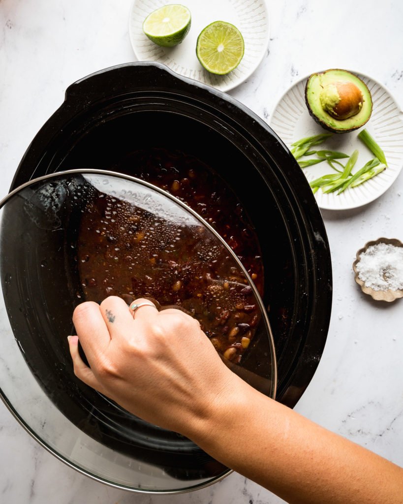 overhead of a slow cooker with chili in it