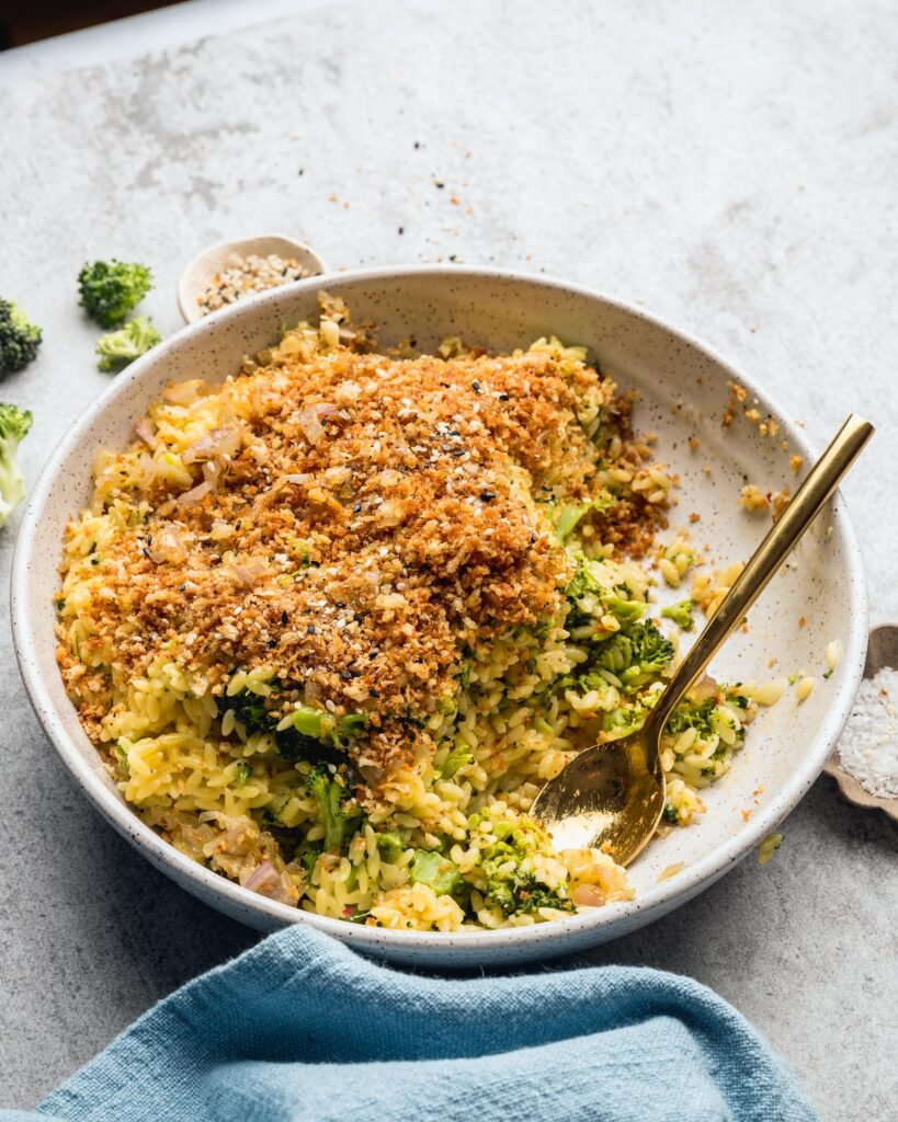 half eaten Cheddar Broccoli Orzo with Everything Bagel Spice Mix Breadcrumbs